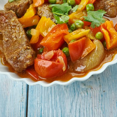 Filipino beef Caldereta, dish is cooked in a tomato-based sauce with vegetables